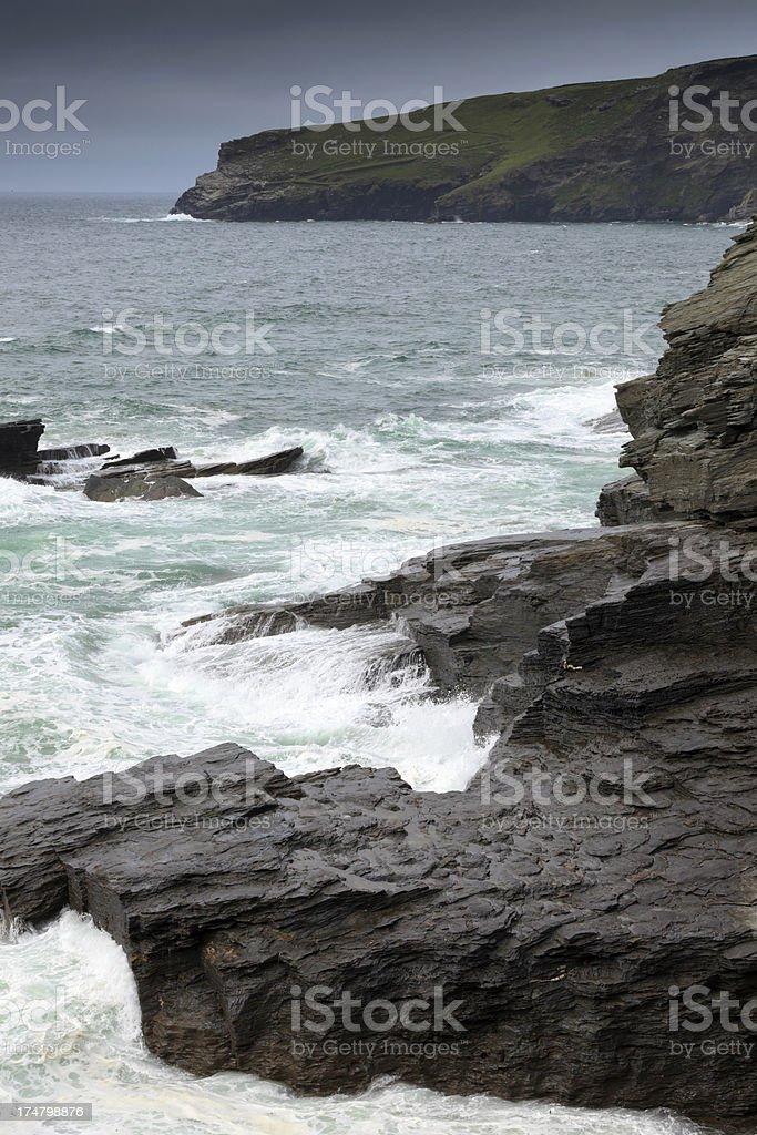 coastal cliffs and rocks at Trebarwith Strand in Cornwall royalty-free stock photo