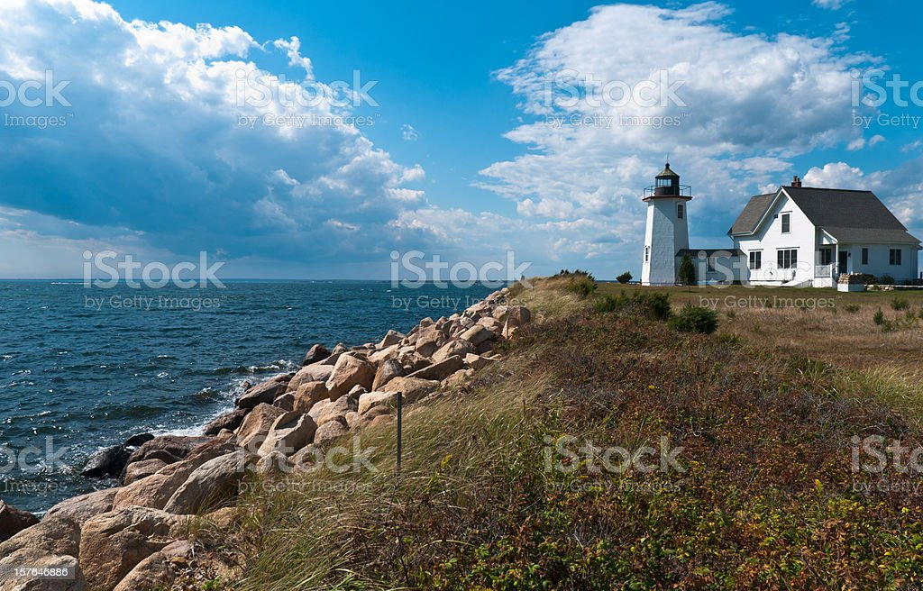 A coastal daytime view of a Cape Cod Lighthouse stock photo