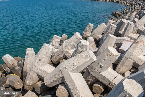 Concrete pre-formed coastal defences known as tetrapods which reduce the effects of the waves (rather than abruptly stopping them) and therefore preventing coastal erosion