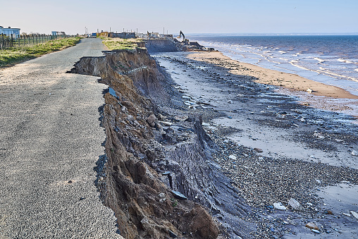a roaded collapsing into the sea due to sea level rise on the Holderness coast -  Climate Change