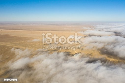 1083309578 istock photo Coastal fog rolling over the skeleton coast. 1166055858