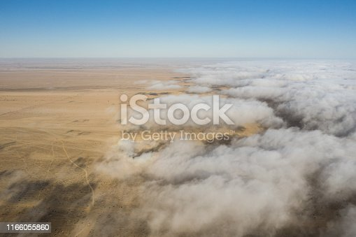 1083309578 istock photo Coastal fog rolling over the skeleton coast. 1166055860