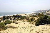 Wild long stretch of sand beach in the dry and wavy coastline north of Mui ne village, Binh Thuan province - Vietnam