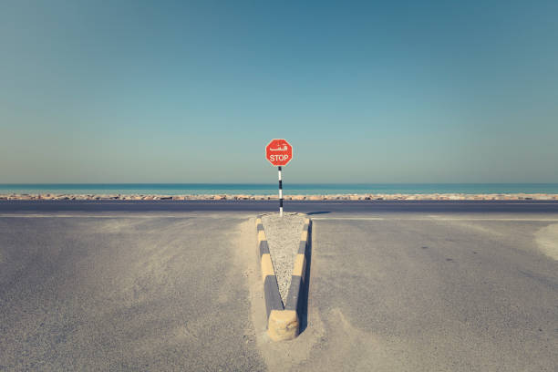 coastal intersection with stop sign stock photo