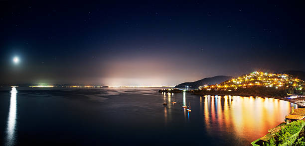 Coastal landscape at night stock photo