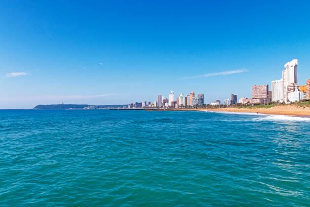 Coastal Landscape Beach Ocean Blue Sky and City Skyline – Foto