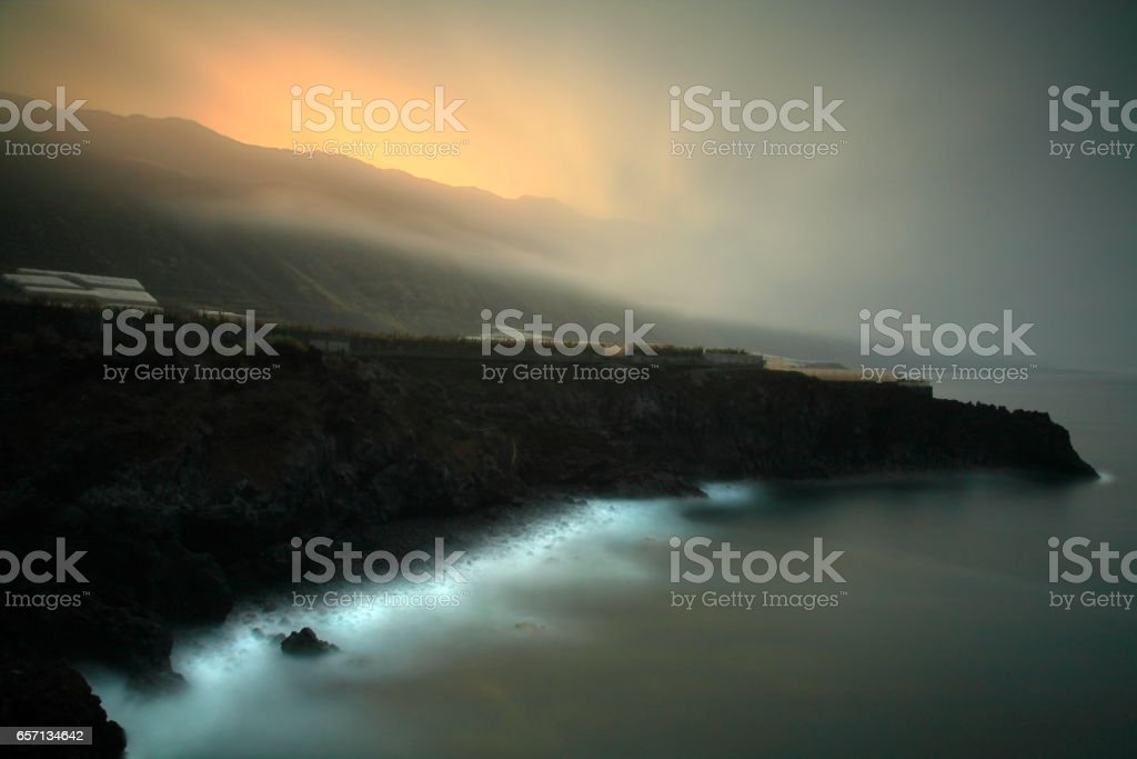 Coastal landscape in the sunrise and Low-hanging clouds stock photo