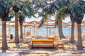 Coastal landscape - view of the beach umbrellas and loungers, city of Varna, on the Black Sea coast of Bulgaria