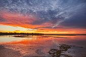 Coastal ocean estuary scene with dramatic morning sunrise, south coast, NSW, Australia