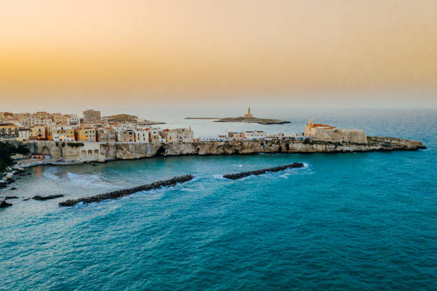 Coastal old town on peninsula at sunset, Vieste, Puglia, Italy stock photo