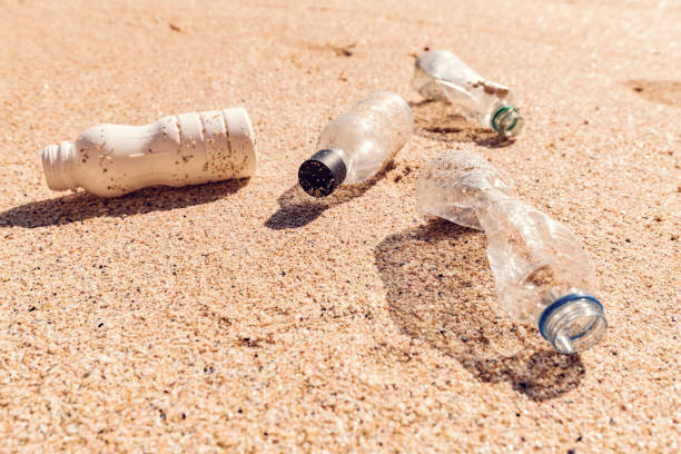 coastal plastic pollution - trash stock photos and pictures