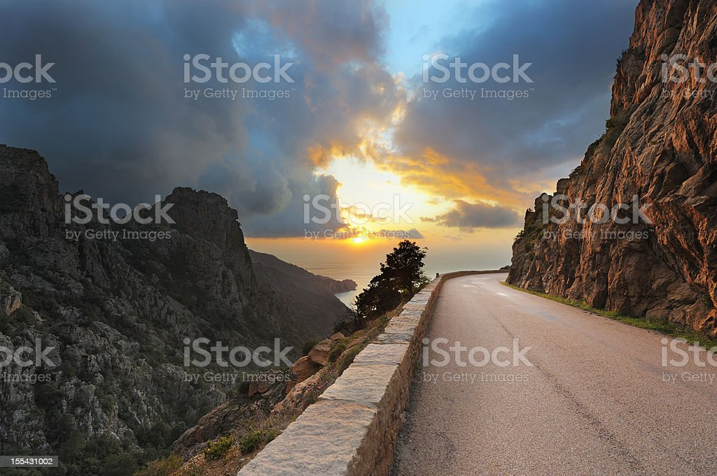 Coastal Road on the Island of Corsica at Sunset stock photo
