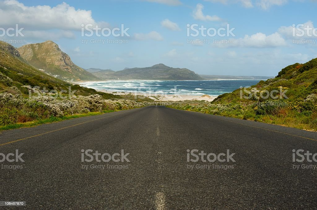 coastal road with seascape and mountains in south africa stock photo