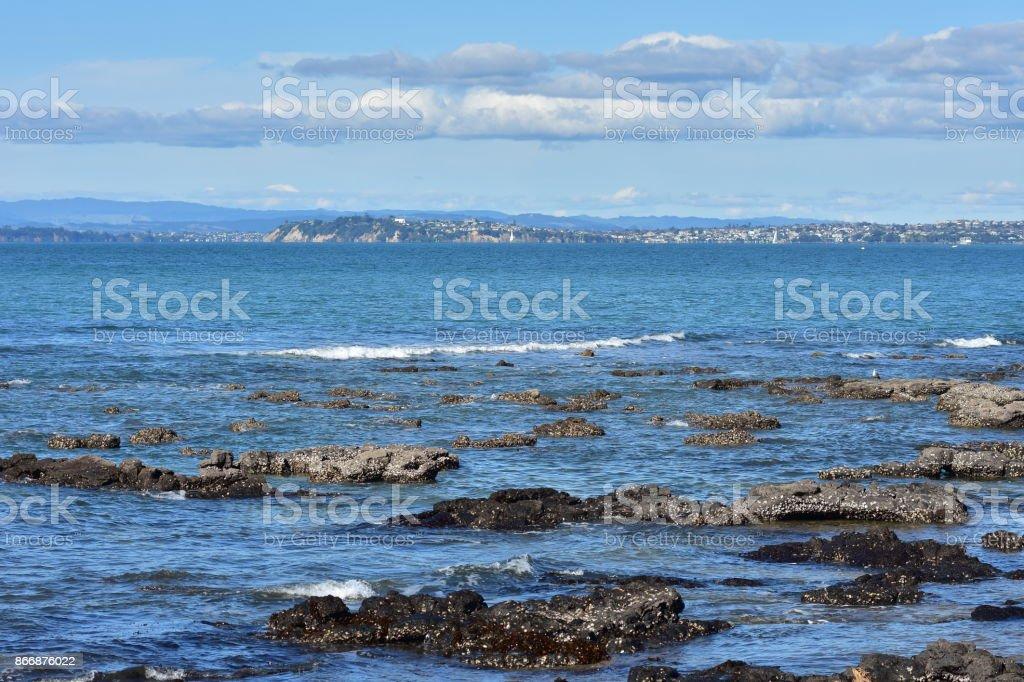 Coastal rocks in Milford stock photo