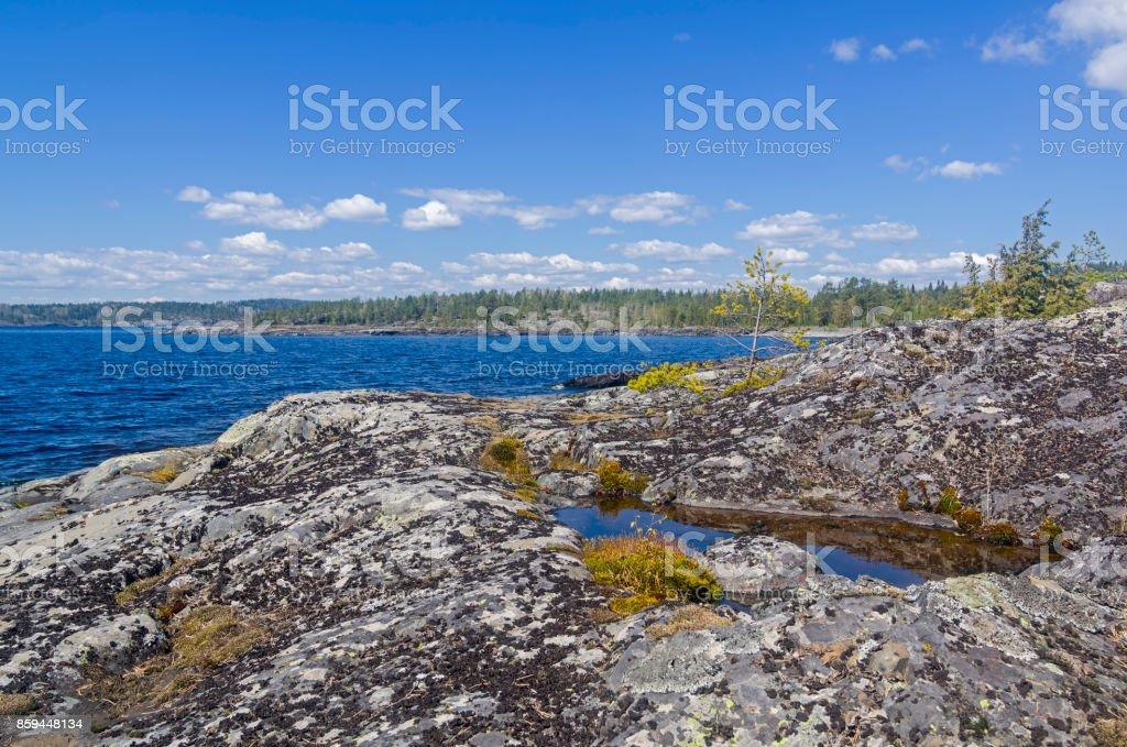 Coastal rocks on Ladoga Lake. stock photo