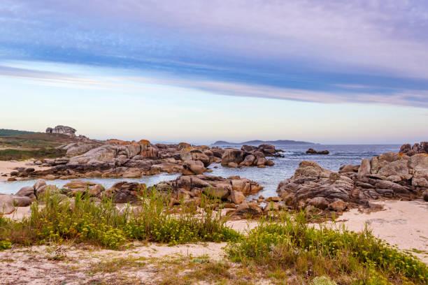 Coastal rocks with Ons Island at background stock photo