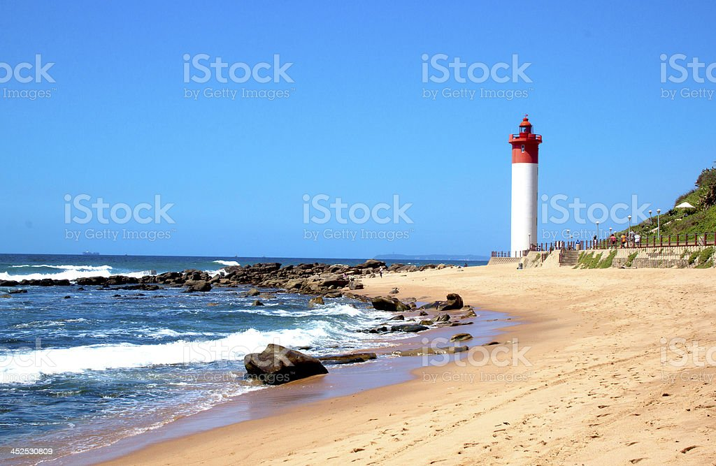 Coastal Seascape With Red and White lighthouse stock photo