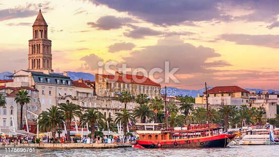 Coastal summer cityscape - view of the promenade the Old Town of Split with the Palace of Diocletian and bell tower of the Cathedral of Saint Domnius, the Adriatic coast of Croatia