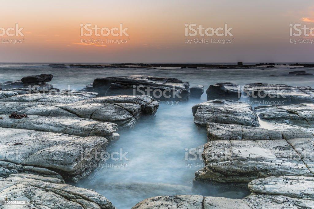 Coastal Sunrise and Rock Platform stock photo