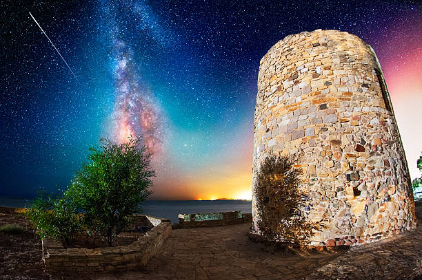 Coastal tower under the milky way stock photo
