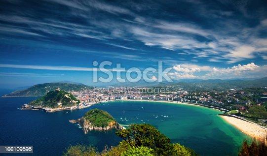 istock Coastal view of San Sebastian with city on shoreline 166109595