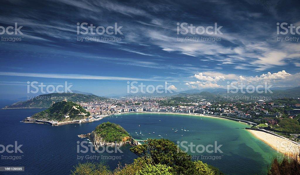 Coastal view of San Sebastian with city on shoreline stock photo