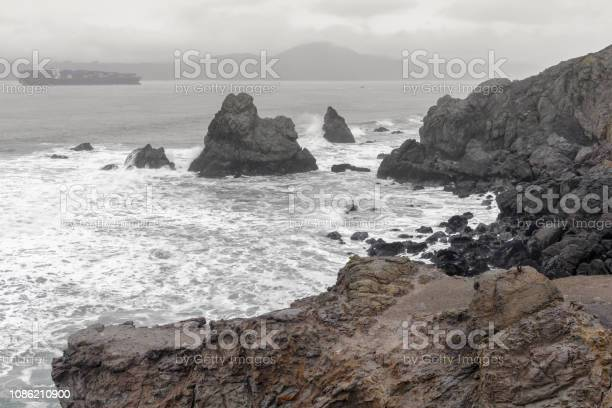 Photo of Coastal views from Land's End towards the Golden Gate strait on a winter day.