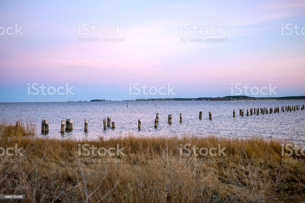 Coastal winter Sunset shot with water and colorful clouds. stock photo