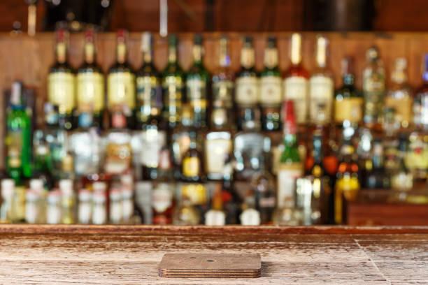 coaster under glass on blurred bar background stock photo