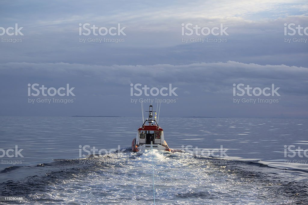 Coastguard jet powered inflatable towing a broken down boat stock photo