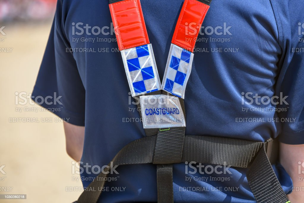 Coastguard with safety gear stock photo