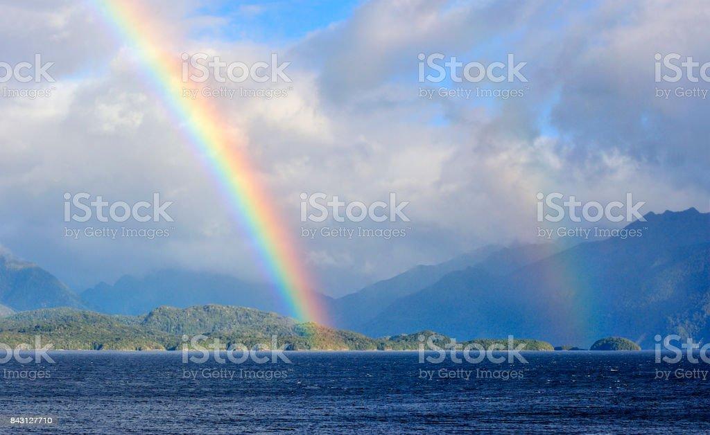 Coastline and Rainbow, New Zealand stock photo