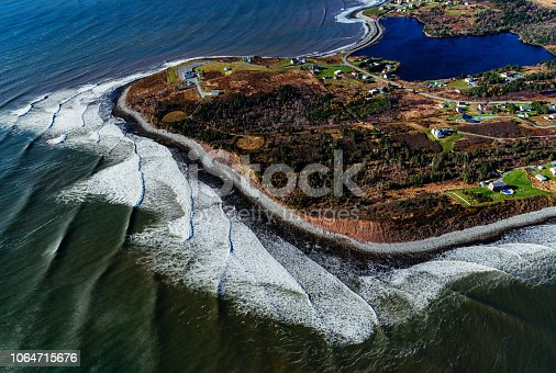 Aerial view of morning light and surf on Nova Scotian coastline.
