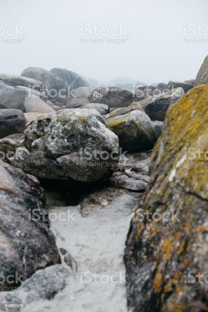 Coastal rocks and cloudy sky on the seashore peninsula O Grove,...
