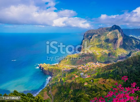 Aerial view over Faial city fort and Santana region on the ocean coast of Madeira island, Portugal