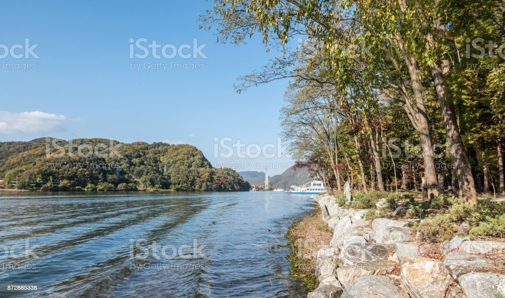 Coastline of Nami Island in South Korea with a ferry stock photo