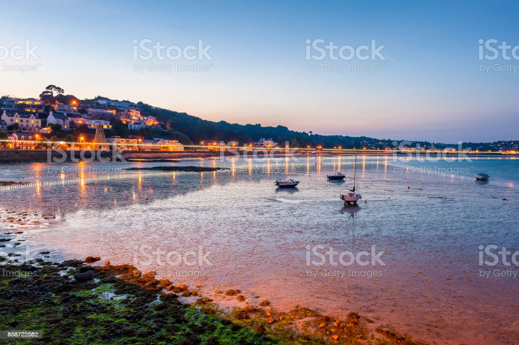 Coastline of Saint Aubin Jersey at low tide and sunset stock photo