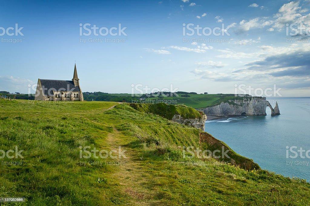 Coastline view of chapel and ocean stock photo