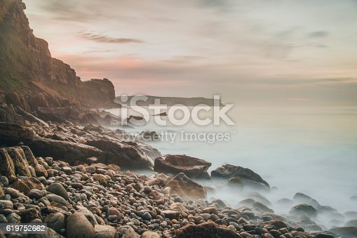 Some rocks emerging from the sea. Long exposure effect to give softness to the water