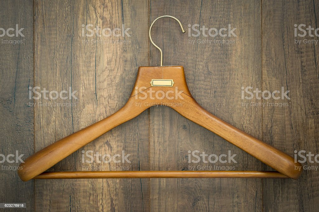 Coat hanger on wood board laundry shop business concept. stock photo