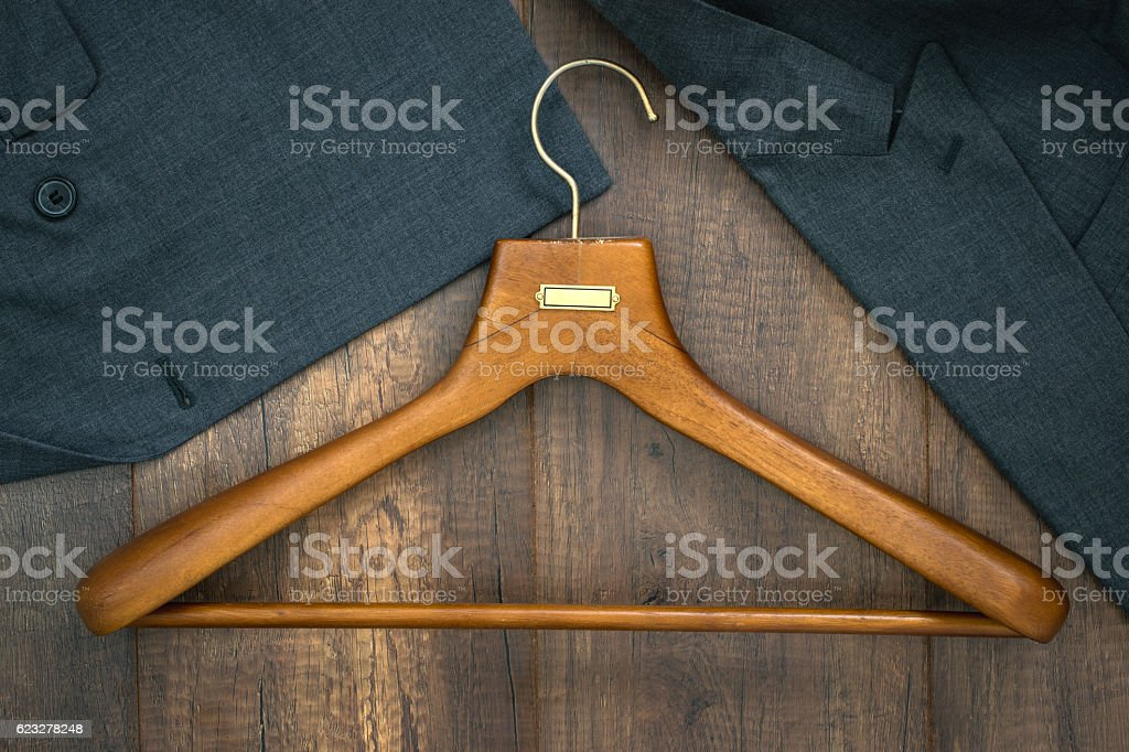 Coat hanger with suit on wood board laundry shop. stock photo