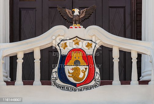 Puerto Princesa, Palawan, Philippines - March 3, 2019: Iwahig Penal Colony. Closeup of Coat of Arms as seen on Recreation Hall, and as was valid between 1933-1946.