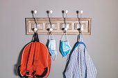 Coat rack of a school boy in a new normality