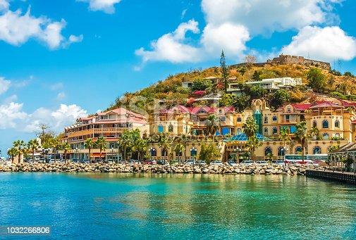 A modern stucco shopping center on the coast of a tropical island