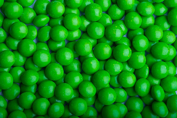 Coated green candy stock photo