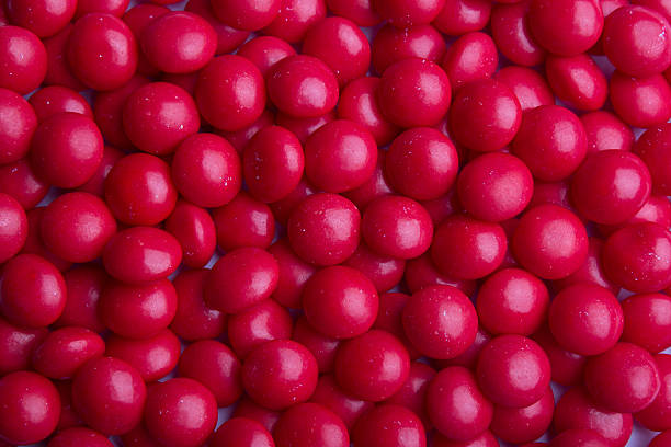 Coated red candy stock photo