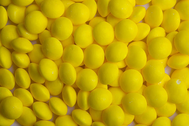 Coated yellow candy stock photo