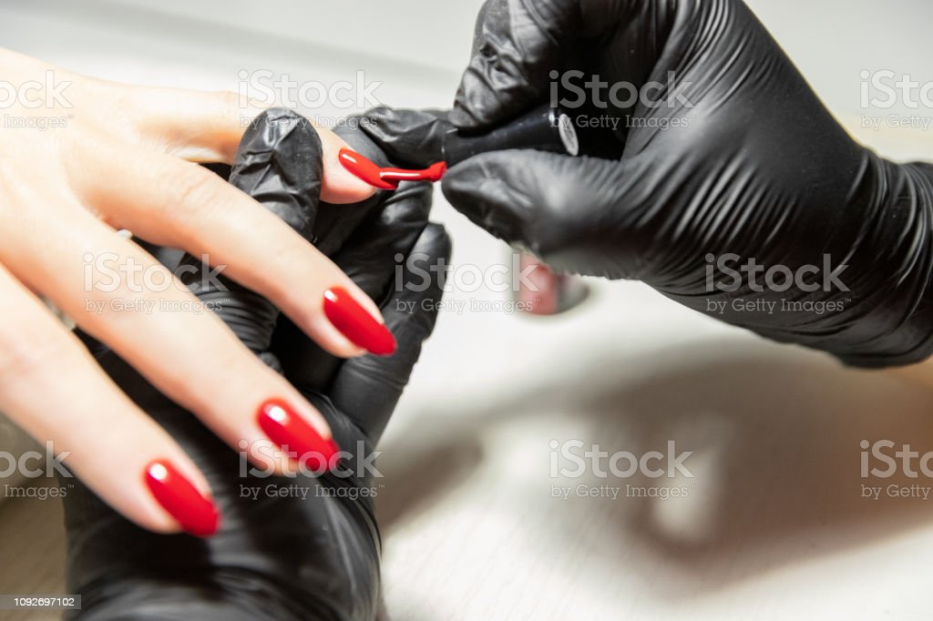 The process of creating the perfect red manicure. Women\'s Concept....