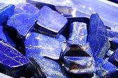 Cobalt blue lapis lazuli stones. Selected focus.
