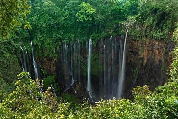 coban sewu  waterfall,  lumajang, jawa,  indonesia - mahroch stock pictures, royalty-free photos & images